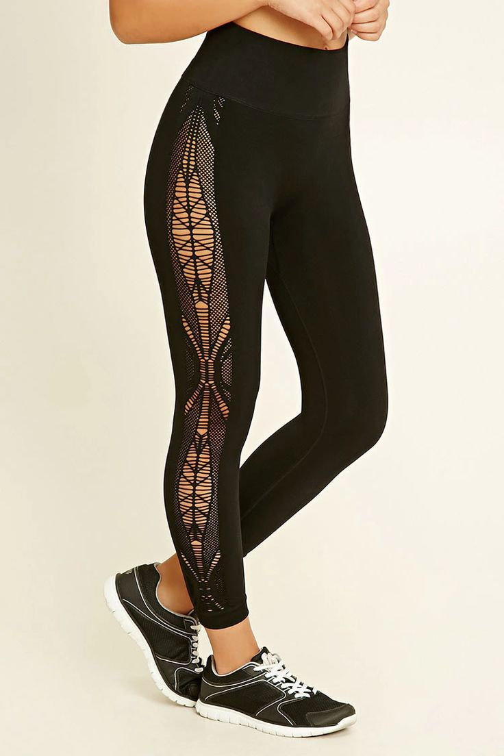 A pair of seamless capri leggings featuring ornate cutout patterns on the sides,...
