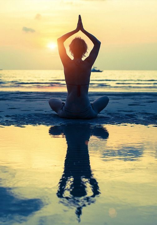 Calming beach yoga.