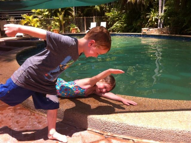 Crocodile Pose and Superman Pose by the pool in the Northern Territory of Austra...