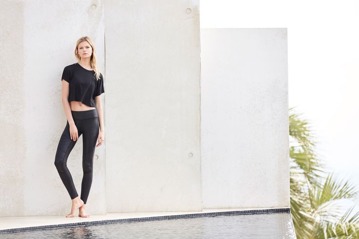 ALO YOGA Moto Legging in Black Performance Leather and the Veil Short Sleeve Top...