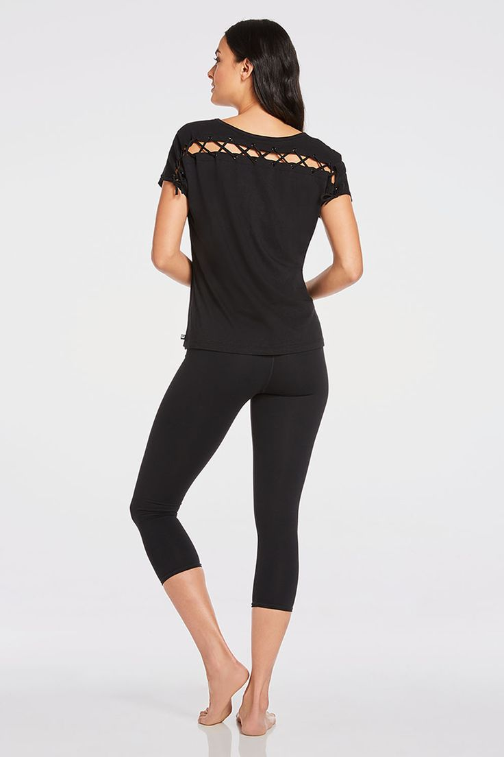 It's easy to live on the edge in our fashion forward tee with a lace-up back...