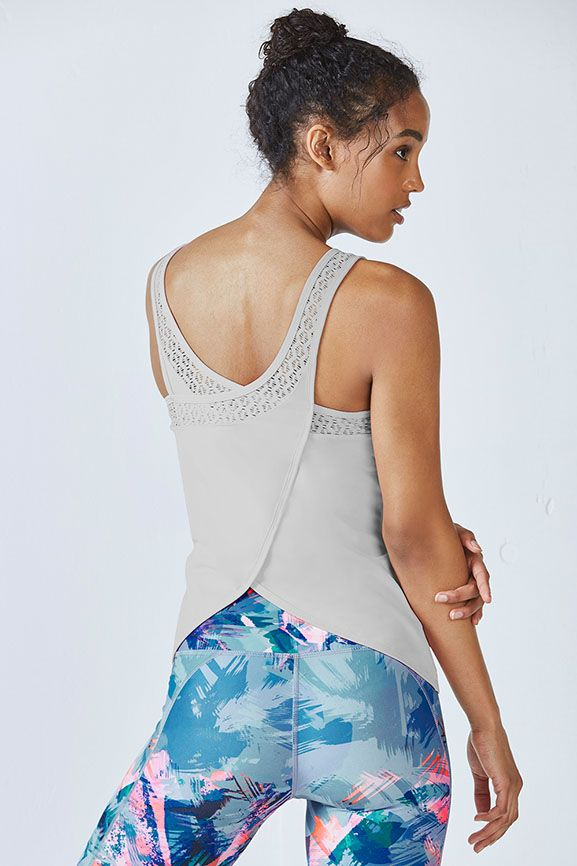 Shape up in our draped, open-back performance tank with a delicate lace trim for...