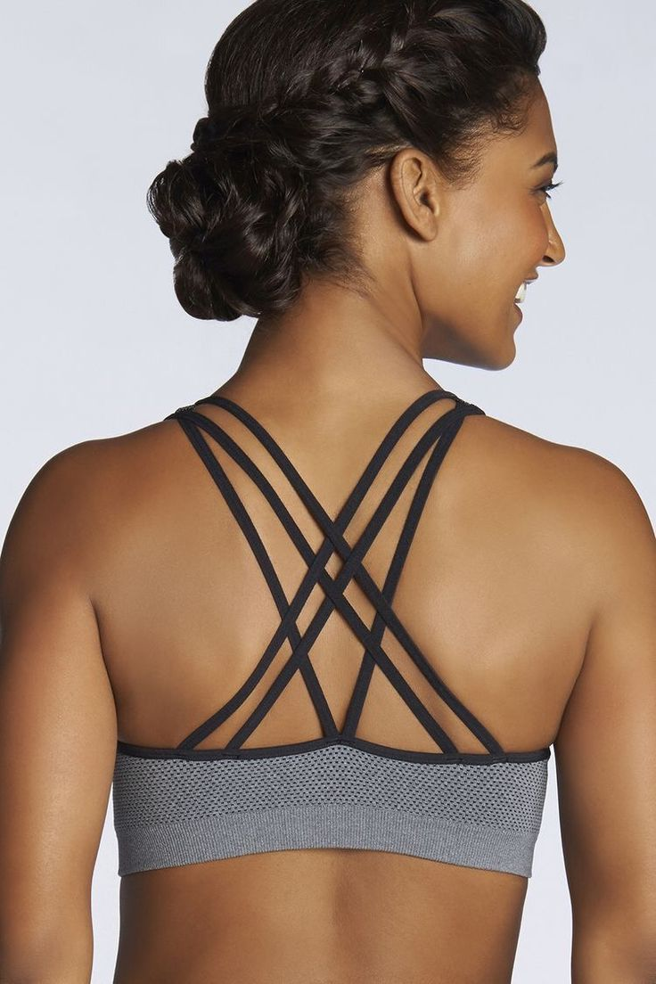 Try Fabletics today! Love this black and grey cris-cross detail sprots bra. Such...