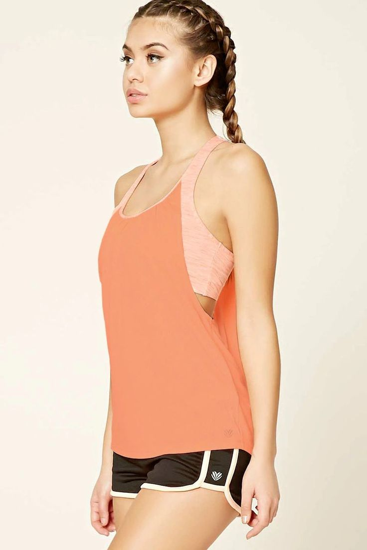 A mesh knit athletic racerback tank featuring a ruched back, dropped armholes, r...