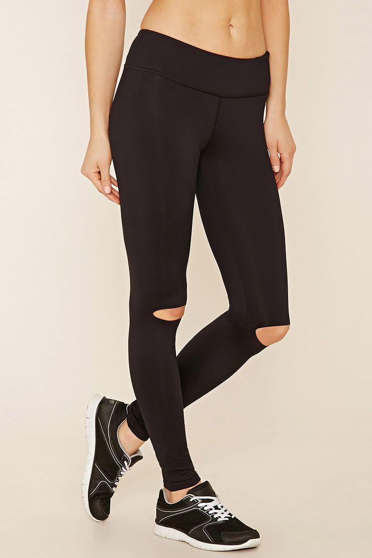 A pair of knit leggings with ripped knees, a hidden key pocket, and moisture…