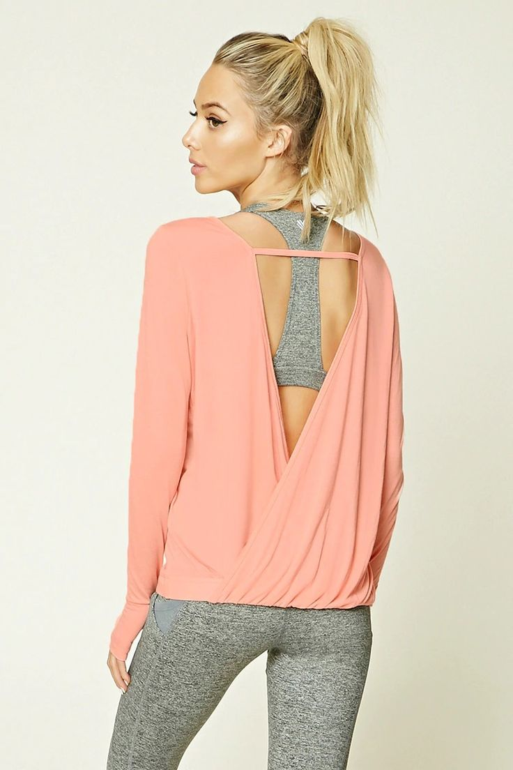 A slub knit athletic top featuring an open surplice back, a round neckline, long...