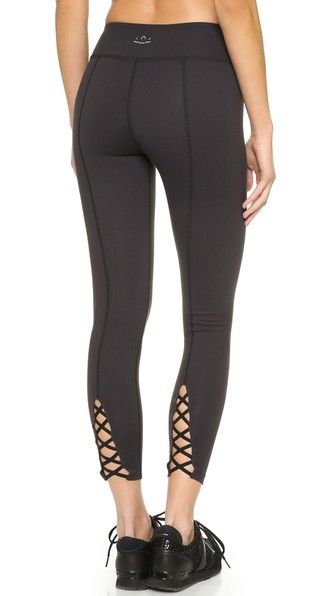 Thin straps crisscross the ankle cutouts on these cropped Beyond Yoga leggings.
