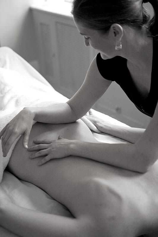Shari Auth using forearms for massage.