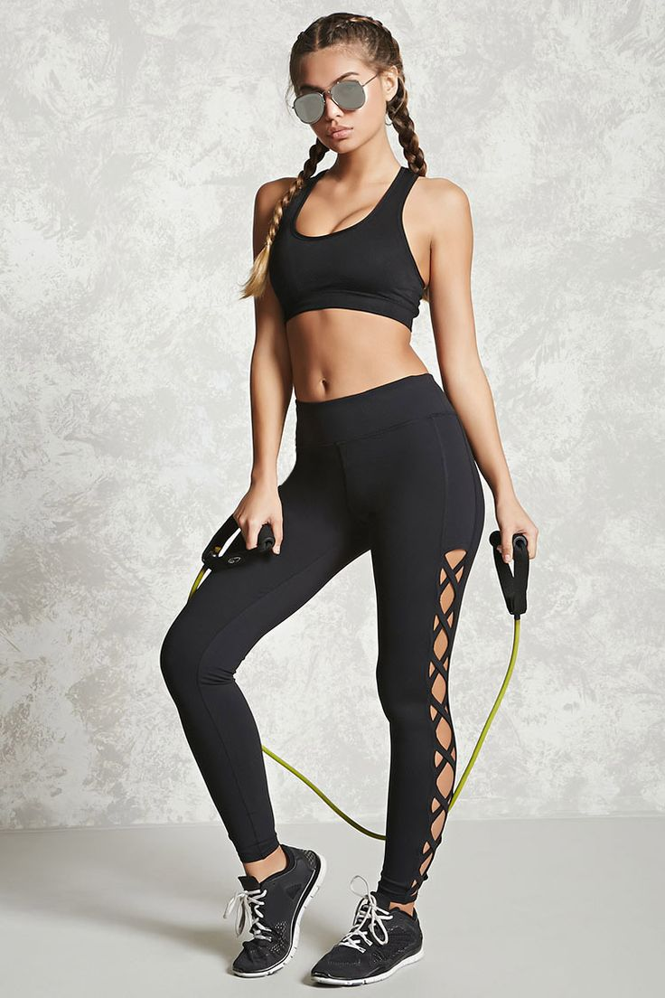 An athletic pair of long stretch-knit leggings featuring crisscross cutouts down...