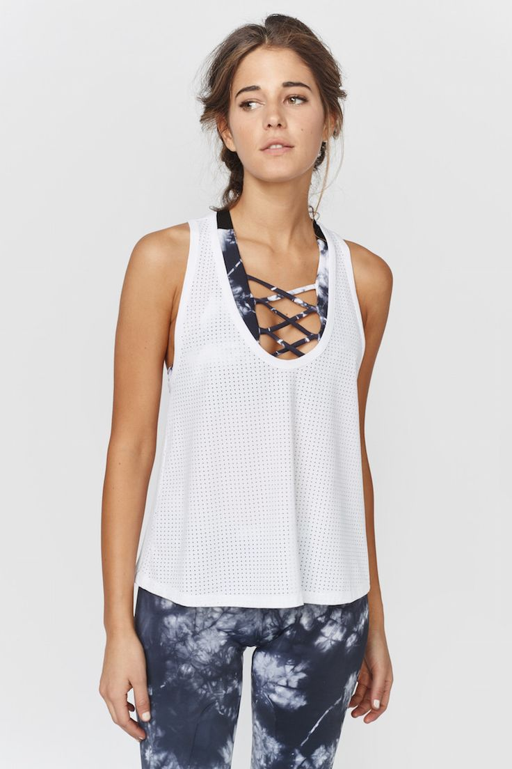 Ready to sweat in style? The Scoop Tank has you covered. Offering a relaxed and ...