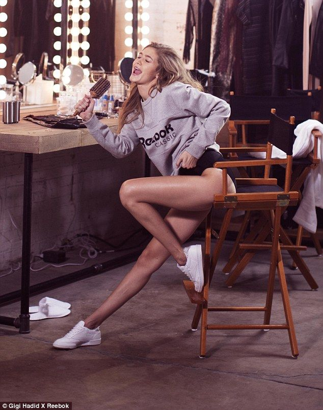 Having a whale of a time: Sitting on a high chair, the statuesque model showed o...