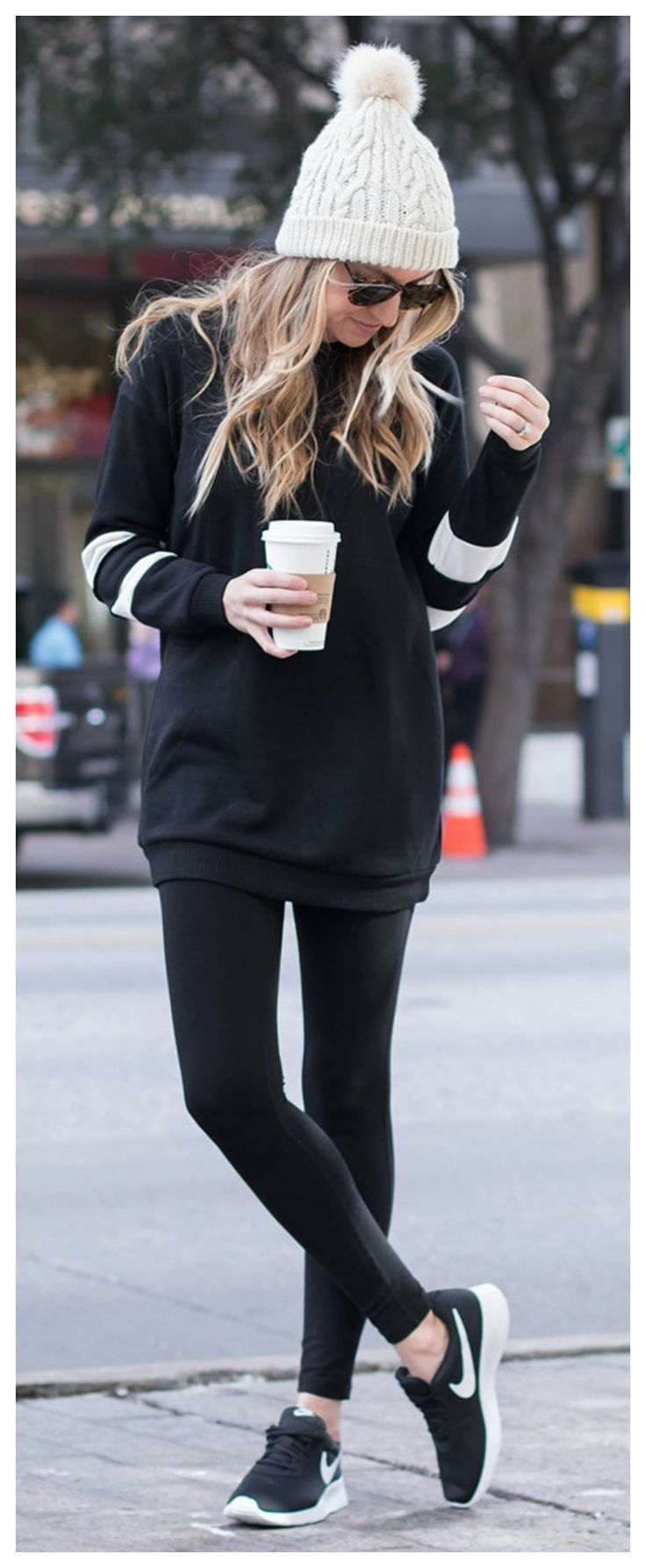 The perfect winter outfit! Black leggings, tunic sweatshirt, beanie, and Nikes. ...