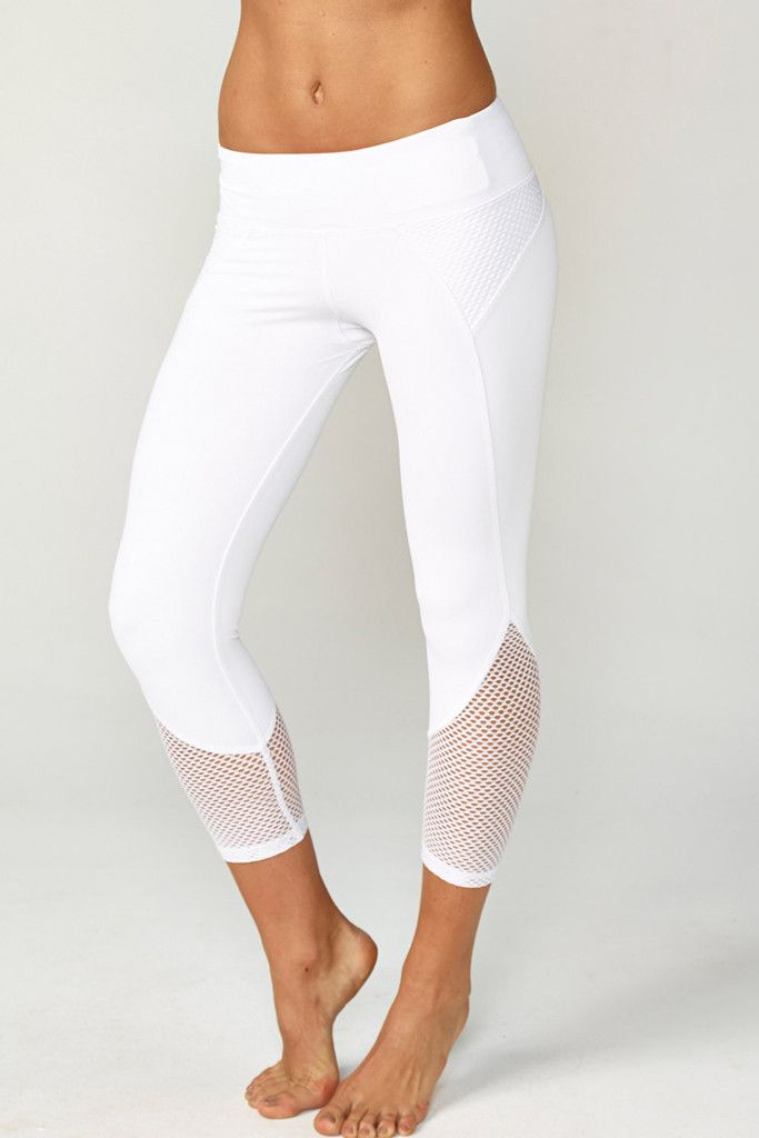 A sleek fashion-forward cropped legging with mesh insets at hips and calves. Com...