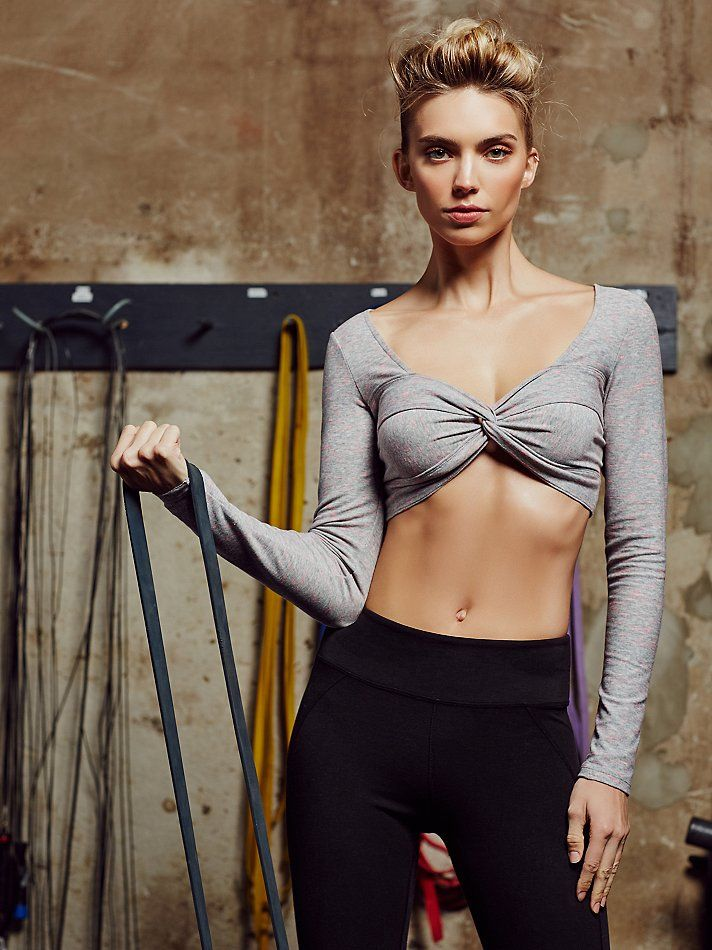 cropped at natural waist line, cinched at bust, thumb holes, warm material.