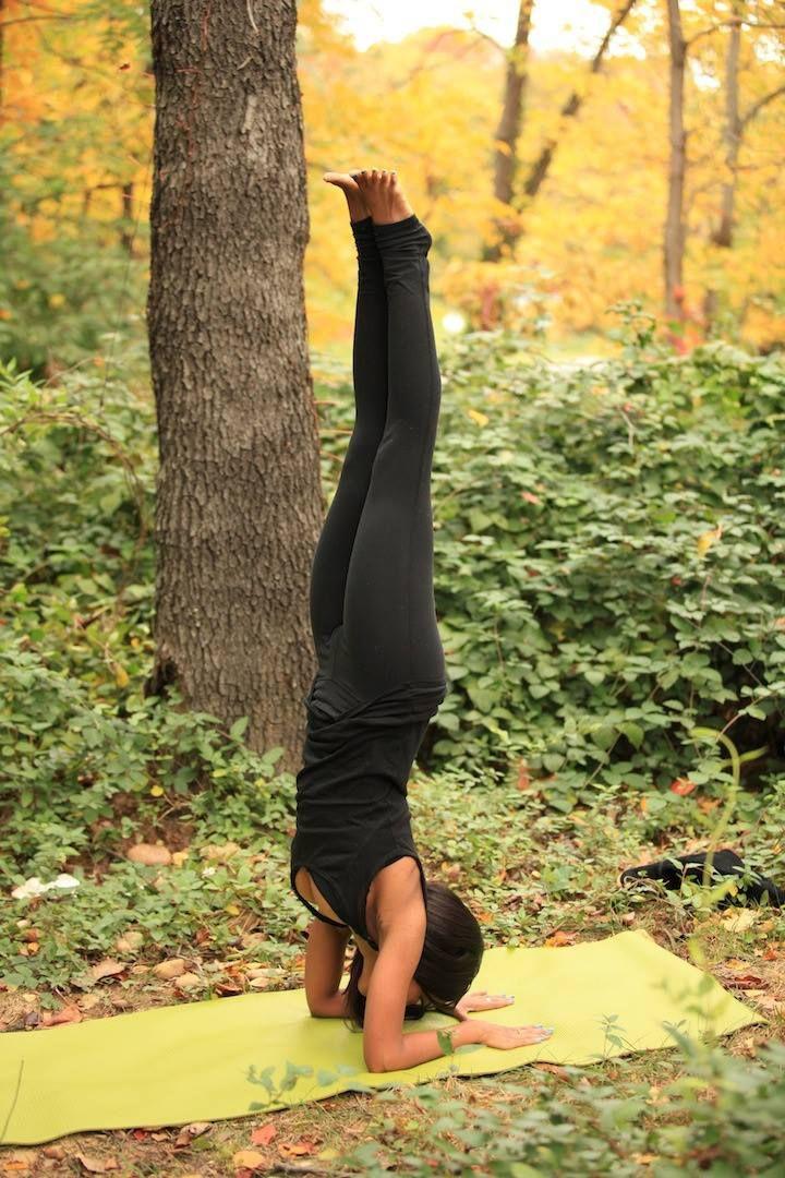 Woman doing headstand yoga pose in the forest. #yoga #yogi #yogapose #ashtanga #...